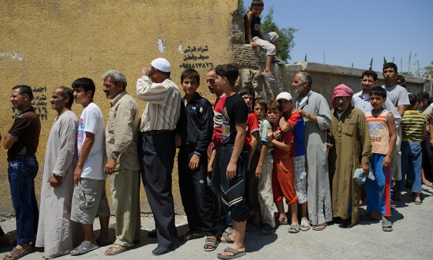 Syrians queue to buy bread from a bakery run by the Free Syrian Army (FSA) in the northern city of Aleppo on toaday. Bags of eight pieces of bread were sold for 15 Syrian pounds (about 25 cents).