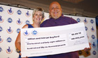 EuroMillions jackpot winners Gill and Adrian Bayford, from Suffolk, with their £148.6m cheque
