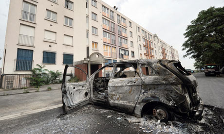 A burnt out car in Amiens, France