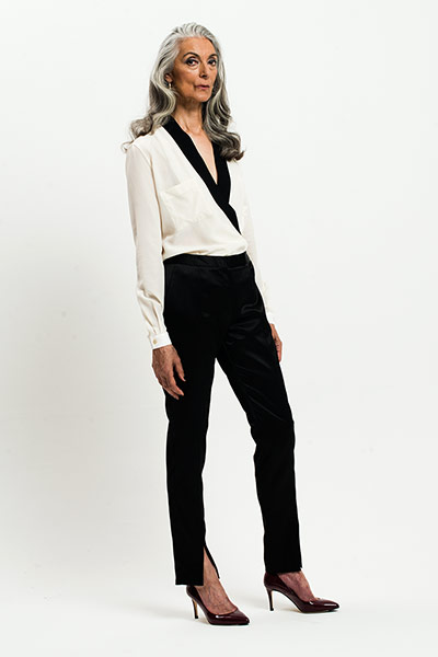 All Ages: Monochrome: Model wears white shirt with black trim and black trousers