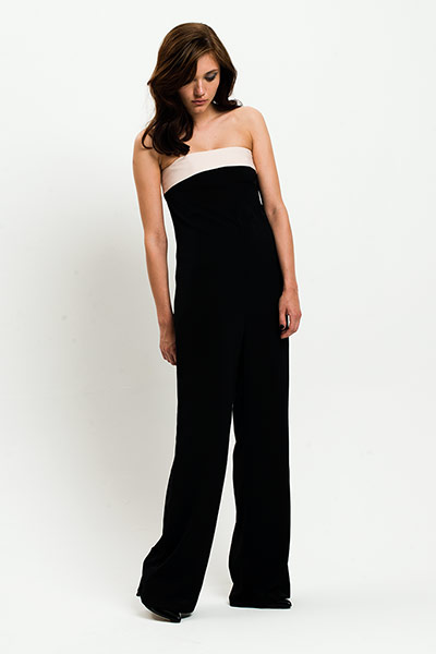 All Ages: Monochrome: Model wears black jumpsuit with white band along the top