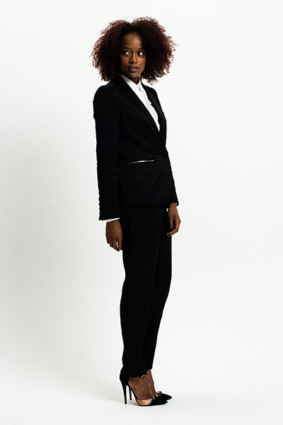 All Ages: Monochrome: Model wears black jacket and trousers with white shirt