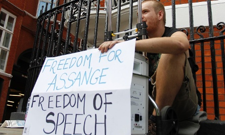 A supporter of WikiLeaks founder Julian Assange shows his support outside the Ecuadorian Embassy