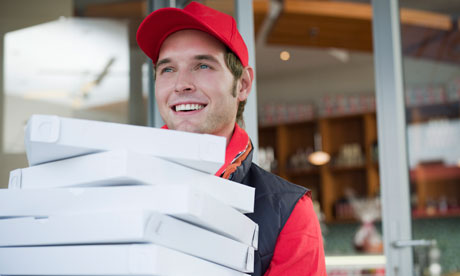 A man delivering pizzas