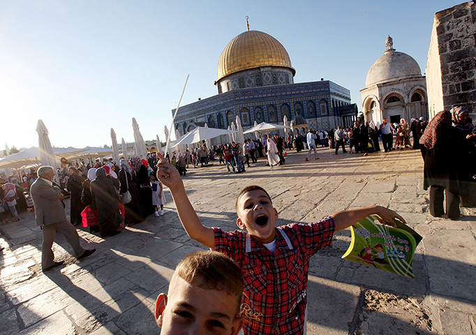 Eid al-Fitr begins: Palestinian children celebrate around the Dome of the Rock at al-Aqsa