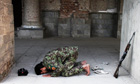 Afghan army soldier prays near Kabul