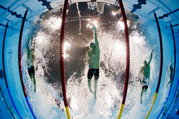 nightswimming us swimmer michael phelps competes in the mens 200m individual medley robotic cameras