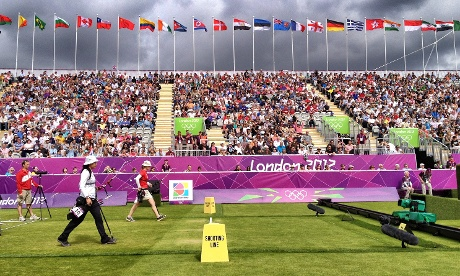 The Women's archery competitors step up to their positions