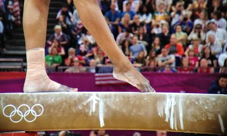 Team USA's Gabrielle Douglas feet on the bar