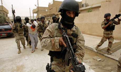 Iraqi troops escort suspected al-Qaida leader