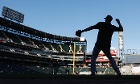Nice silhouette: New York Yankees shortstop Derek Jeter warms-up before his MLB American League baseball game against the Chicago White Sox in Chicago last night.