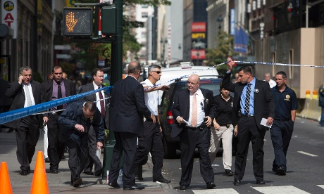 Law enforcement officials at the scene of a shooting near the Empire State Building in New York.