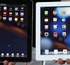 A Samsung Galaxy Tab tablet computer (left) and an Apple iPad