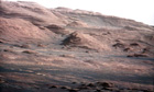 The Mars Curiosity rover's first high-resolution picture shows the layered face of Mount Sharp