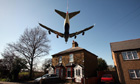 A plane comes in to land at Heathrow airport