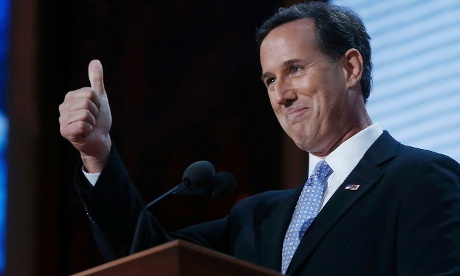 Former presidential candidate Rick Santorum gives a thumbs up gesture as he addresses delegates of the  RNC.