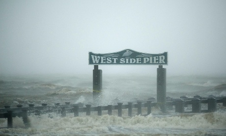 Surf washes over the West Side Pier as Hurricane Isaac passes through Gulfport, Mississippi.