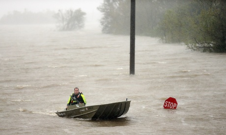 A rescue boat passes a partially submerged stop sign during Hurricane Isaac in Braithwaite, in Plaquemines Parish, Louisiana.