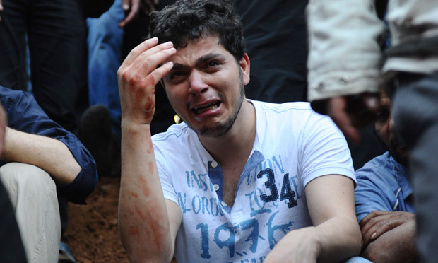 A Syrian man mourns people killed in Jdeidet Artouz near Damascu