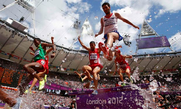 Athletes compete in the men's 3000m steeplechase round 1 heat