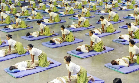Some 641 Thai masseurs and masseuses perform massages as they establish a new Guinness World Record for Thai massage at an indoor sport arena on the outskirts of Bangkok this morning.