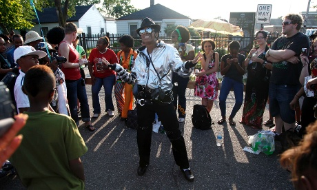 Michael Jackson impersonator Dominique Wilson performs to recorded music outside Jackson's boyhood home during celebrations marking what would have been Jackson's 54th birthday yesterday.