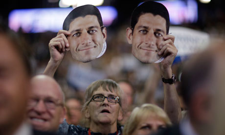 A delegate holds up a mask Paul Ryan at the Republican Convention, Tampa