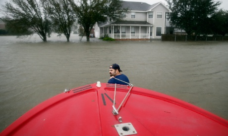 Tropical storm Isaac was downgraded from hurricane status on last night. Henry Cox pulls his boat through deep water to rescue residents from the flood waters in LaPlace after Isaac moved across through Louisiana  Photograph: Chris Graythen/Getty Images