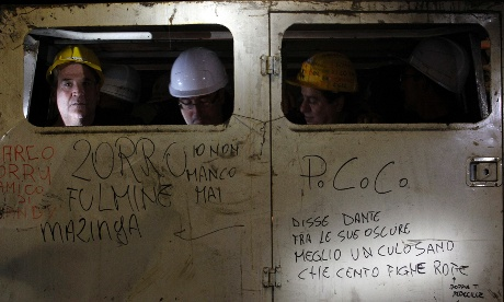 Sardinian miners sit in a truck 1312ft underground during a protest blocking the entrance of the Carbosulcis mine in Carbonia, west of Cagliari, August today. Up to 100 Sardinian miners armed with hundreds of kilograms of explosives have barricaded themselves underground in Italy's only coal mine to put pressure on the Rome government to protect its survival.
