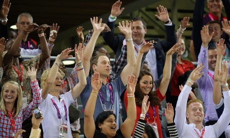 Royal wave:  Prince William and Catherine take part in a Mexican Wave whilst watching the track cycling at the Velodrome
