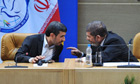 Mohamed Morsi speaks to Mahmoud Ahmadinejad at the Non-Aligned Movement summit in Tehran, Iran
