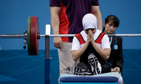 Zeinab Oteify of Egypt brings her hands together in prayer before attempting a lift in the women's -44kg powerlifting competition. Oteify made the lift successfully.