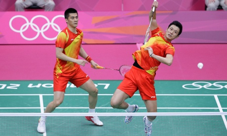 China's Cai Yun, right, and Fu Haifeng in their badminton match against Malaysia