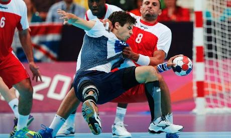 Britain's Gawain Vincent and Tunisia's Wissem Hmam in handball Preliminaries