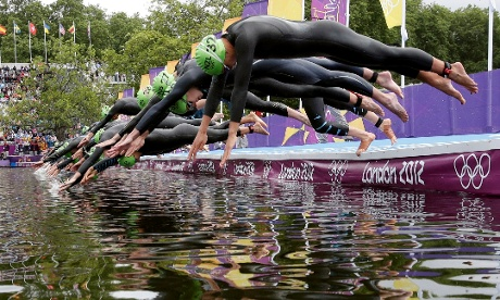 Athletes compete at the start of the women's triathlon final
