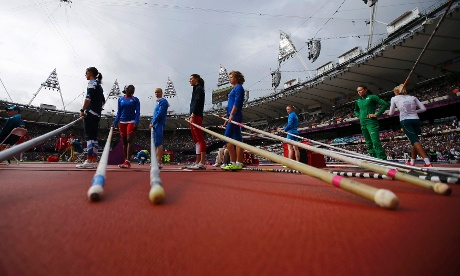 Athletes prepare before the start of the women's pole vault qualification