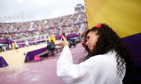 A dancer prepares to perform at Horse Guards Parade before the days beach volleyball matches