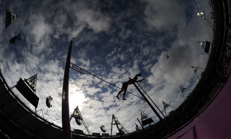 An athlete is dramatically framed by the London sky in the women's pole vault qualifications