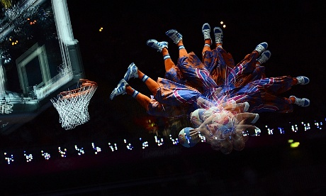A multi-exposure photograph perfectly shows a player scoring in the basketball match between France and Tunisia