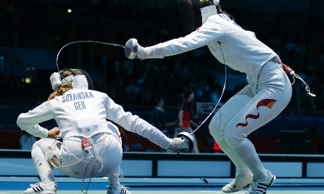 Germany's Monika Sozanska, left, competes with China's Li Na during a match in women's team  fencing.