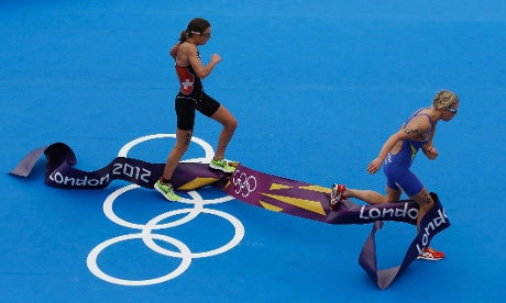Switzerland's Nicola Spirig, left, takes Silver and Sweden's Lisa Norden ( right) takes Gold in the women's triathlon
