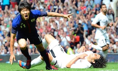 Kensuke Nagai (L) of Japan celebrates scoring a goal during the quarter final soccer match against Egypt in Old Trafford, Manchester