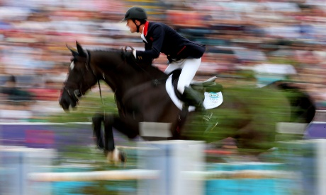Ben Maher of Great Britain riding Tripple X leaps during  the Individual Jumping Equestrian Event