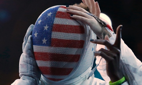 Maya Lawrence of the U.S. prepares to do battle with Italy's Bianca Del Carretto in their women's epee team quarterfinals fencing match.