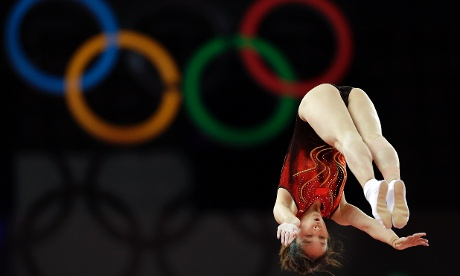 China's Huang Shanshan competes in the women's gymnastics trampoline qualification
