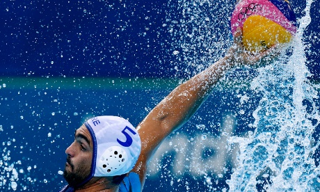 Theodoros Chatzitheodorou of Greece shoots at goal during their men's water polo against Spain
