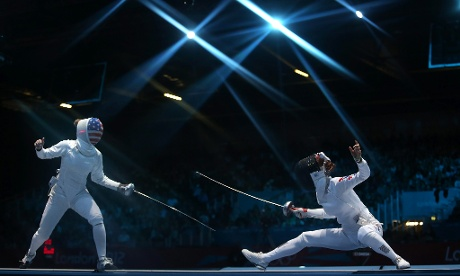 Susie Scanlan of US (L) approaches Injeong Choi of South Korea (R) during their Women's Fencing match