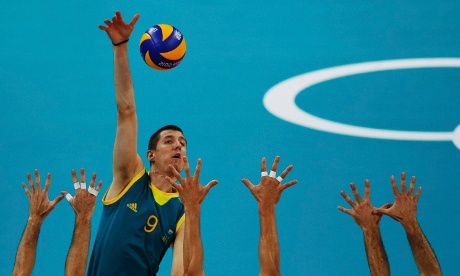Australia's Adam White shoots against Italy during their volleyball match