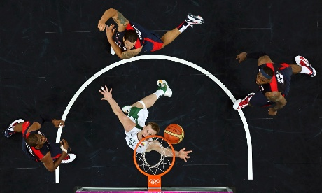 Lithuania's Martynas Pocius (C) Lebron James (L), Deron Williams and Chris Paul (R) of U.S. during basketball match.