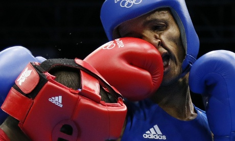 Roniel Iglesias Sotolongo (R) of Cuba in action against Everton dos Santos Lopes in boxing match.